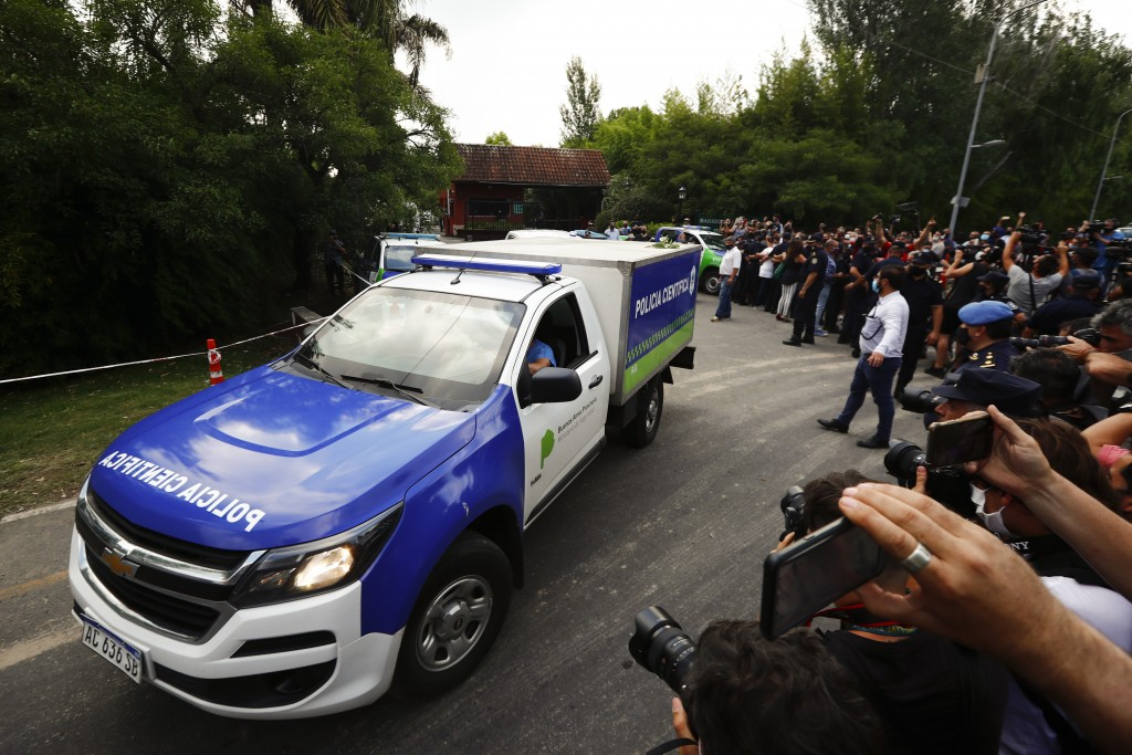 An ambulance carrying the body of Diego Maradona leaves his house in Buenos Aires, Argentina, Wednesday, Nov. 25, 2020. The Argentine soccer great who...