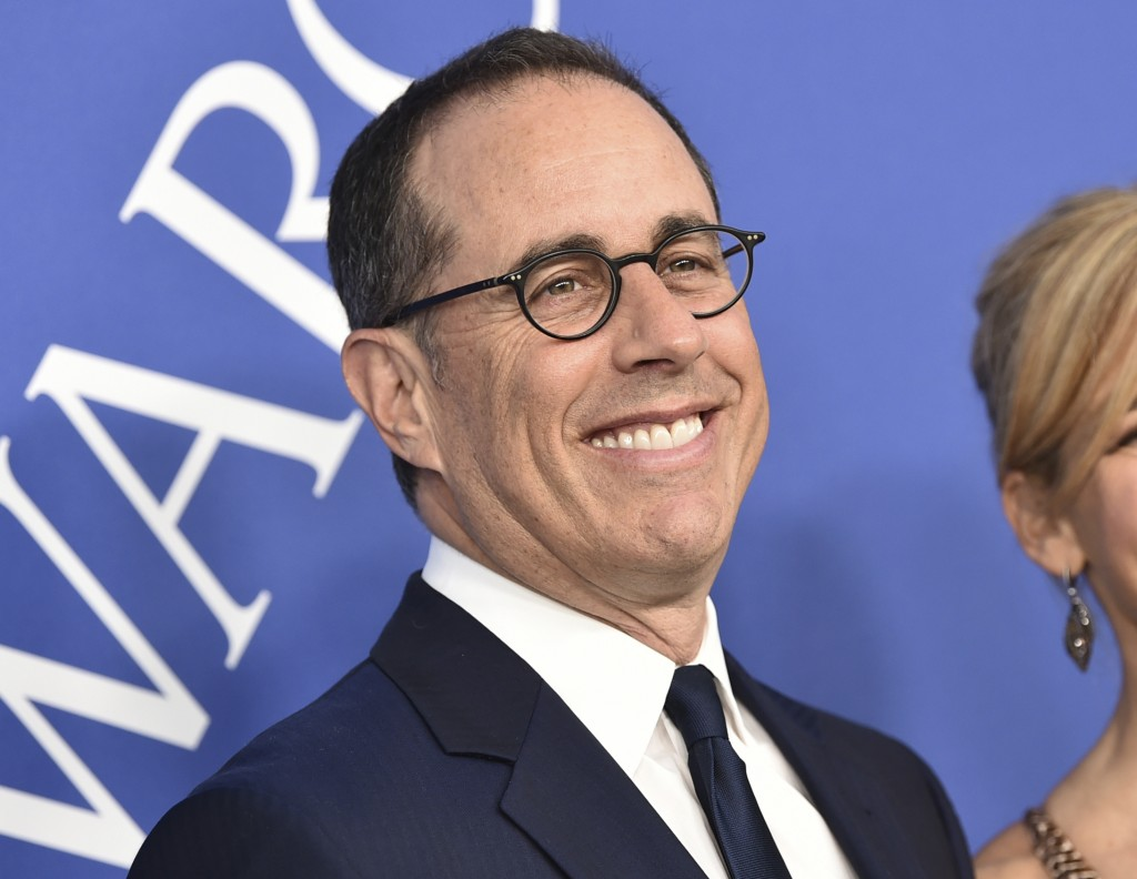 """FILE - Jerry Seinfeld arrives at the CFDA Fashion Awards at the Brooklyn Museum in New York on  June 4, 2018.  In Seinfeld's new book, """"Is This Anythi..."""