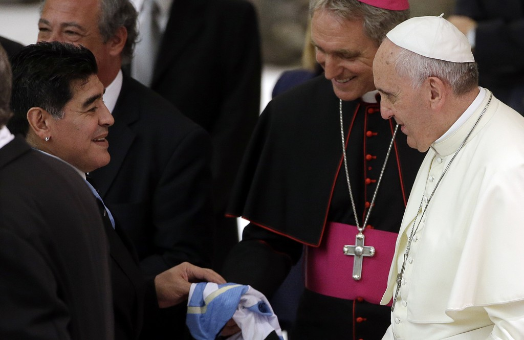 FILE - In this Monday, Sept. 1, 2014 file photo, Diego Armando Maradona, left, greets Pope Francis in the Paul VI hall at the Vatican, ahead of an int...