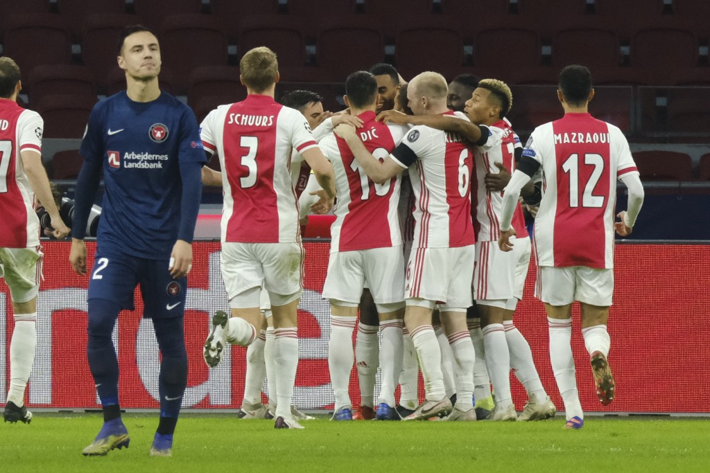 Ajax players celebrate scoring their side's first goal during the group D Champions League soccer match between Ajax and Midtjylland at the Johan Cruy...
