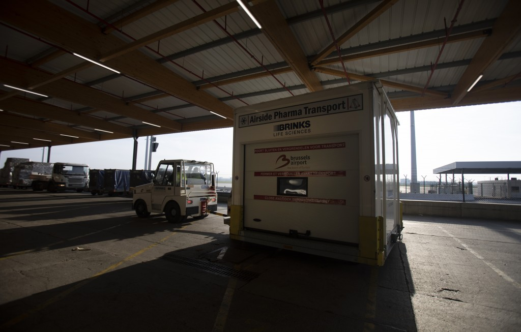 Cargo workers demonstrate the cold chain handling of medicines and vaccines as they drive a pharma transport vehicle at Swissport Pharma Center in Mac...