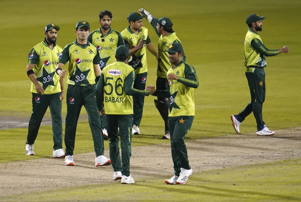 FILE - In this Tuesday Sept. 1, 2020, file photo, Pakistan players celebrate their win in the third Twenty20 cricket match against England at Old Traf...