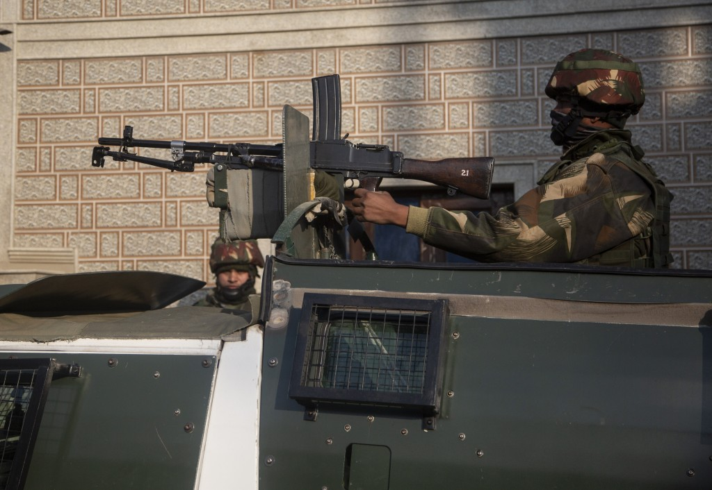 Indian security officers keep guard near the site of an attack on the outskirts of Srinagar, Indian controlled Kashmir, Thursday, Nov. 26, 2020. Anti-...