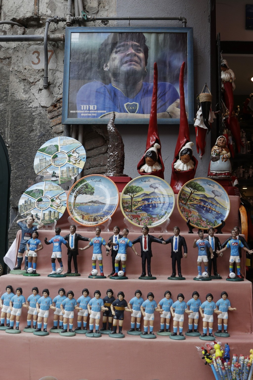 FILE - In this Wednesday, Sept. 18, 2019 file photo, statuettes of soccer legend and former Napoli player Diego Armando Maradona are displayed togethe...