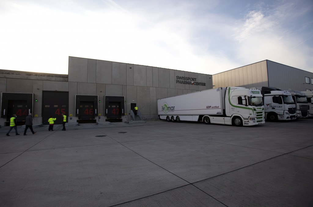 Trucks are parked outside the loading bays at Swissport Pharma Center in Machelen, Belgium, Wednesday, Nov. 25, 2020. Safely delivering COVID-19 vacci...