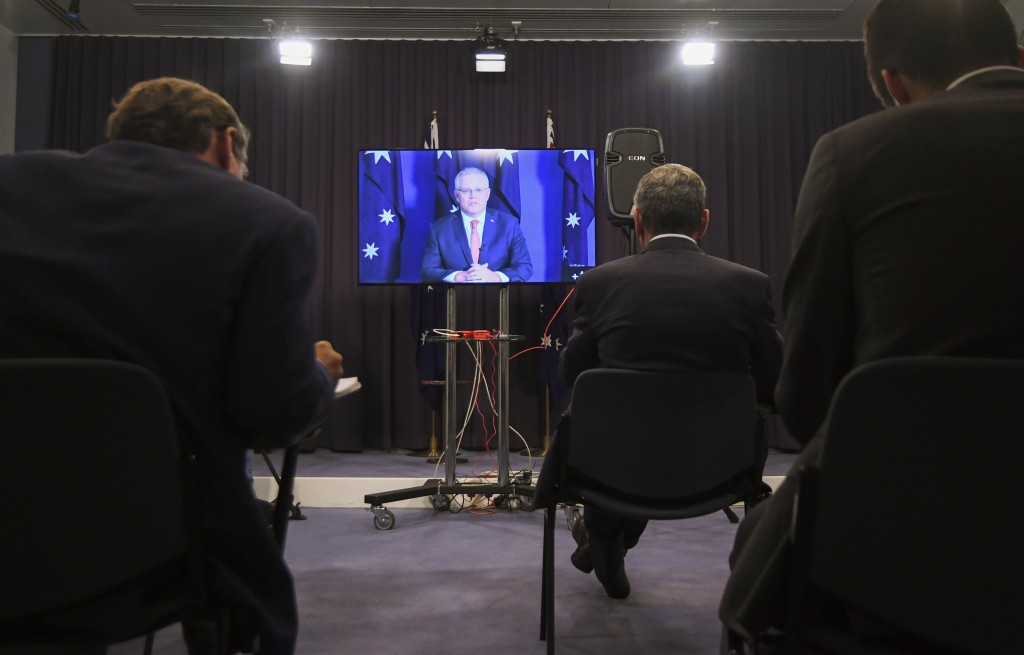 Australian Prime Minister Scott Morrison speaks to the media during a virtual press conference at Parliament House in Canberra, Thursday, Nov. 26, 202...