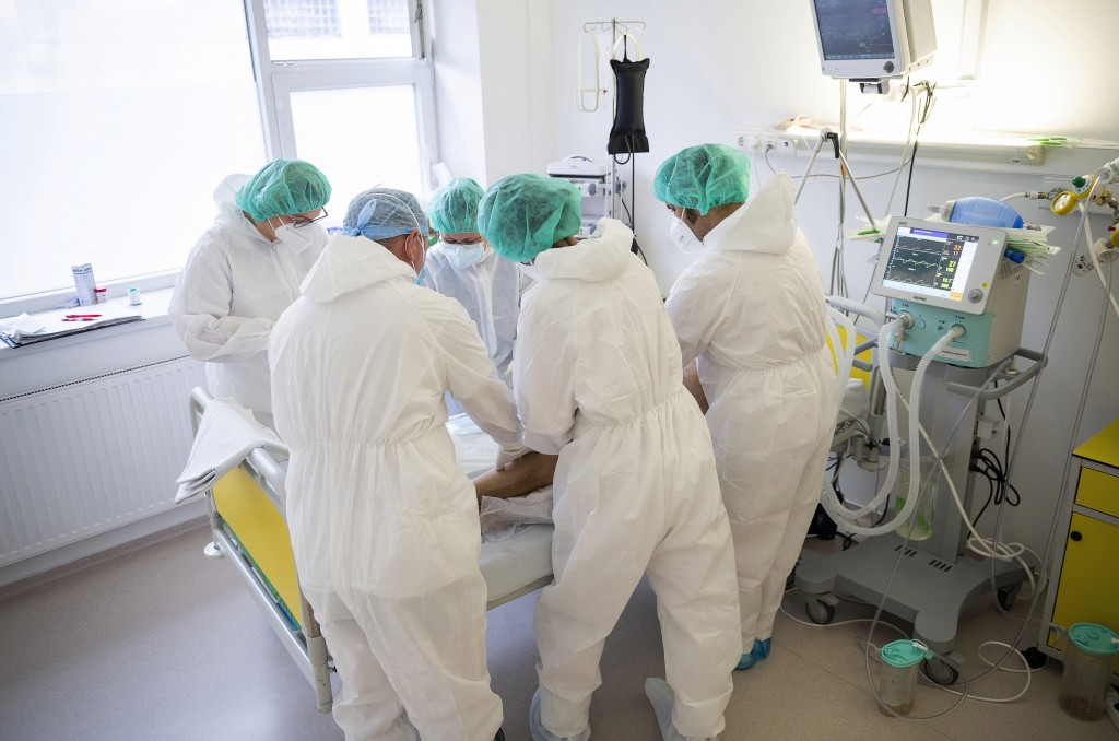 Doctors and nurses attend to a patient at the intensive care unit for COVID-19 patients in the Andras Josa hospital in Nyiregyhaza, Hungary, Thursday,...