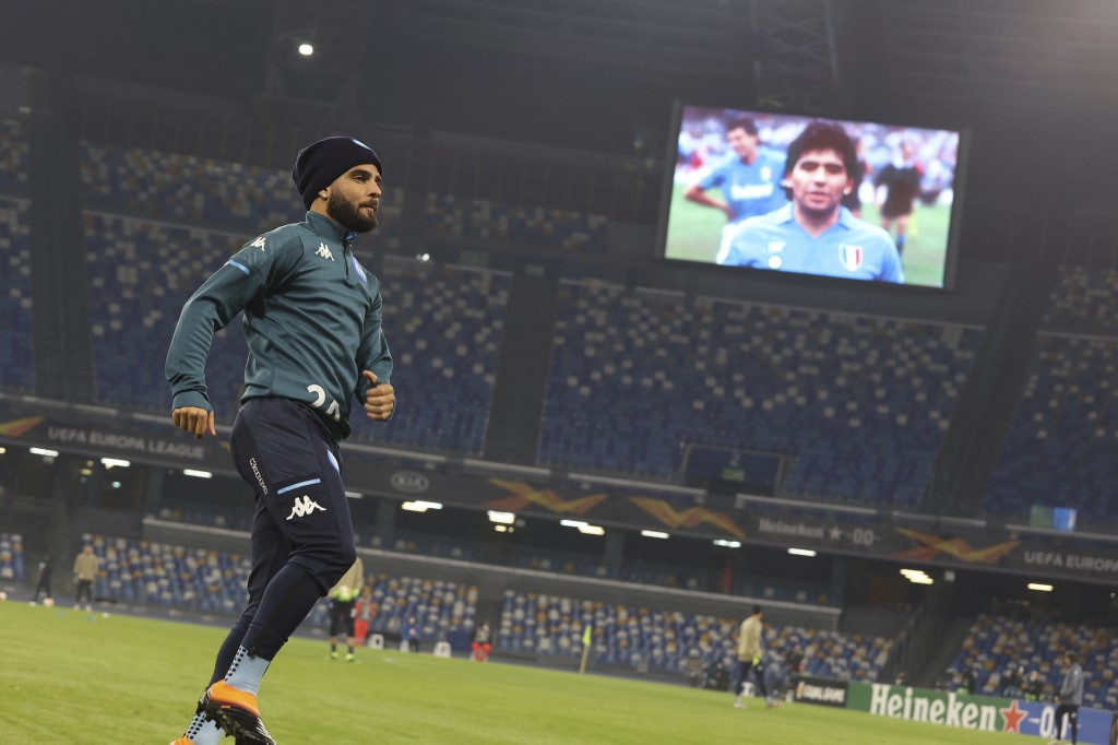 Banners and pictures in memory of Diego Armando Maradona who died yesterday, are shown on the screen before the Napoli against Rijeka group F soccer m...