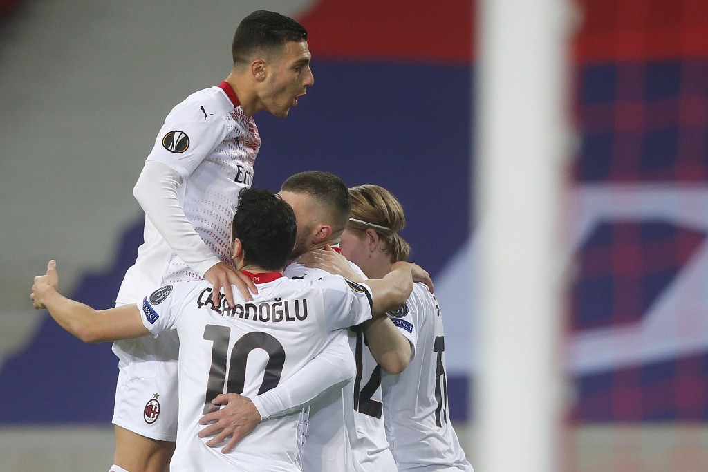 AC Milan players celebrate a goal from their teammate Samu Castillejo against Lille during the Europa League Group H soccer match between Lille and AC...