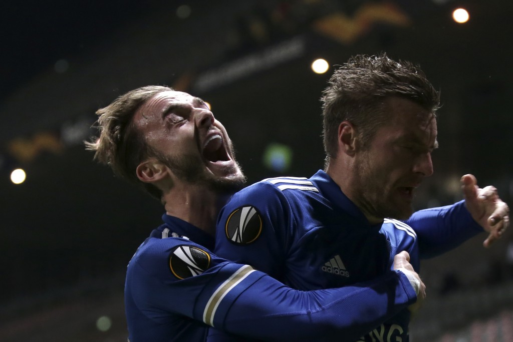 Leicester's James Maddison hugs teammate Jamie Vardy, right, after he scored their side's third goal during the Europa League group G soccer match bet...