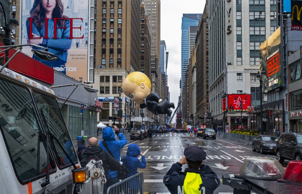 The Boss Baby balloon, viewed from a barricade two blocks away, makes an appearance during the modified Macy's Thanksgiving Day Parade in New York, Th...