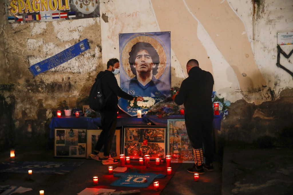 "People gather and light candles to honor soccer legend Diego Maradona, at the popular ""Quartieri Spagnoli"" neighborhood, in Naples, Thursday, Nov. 26,..."