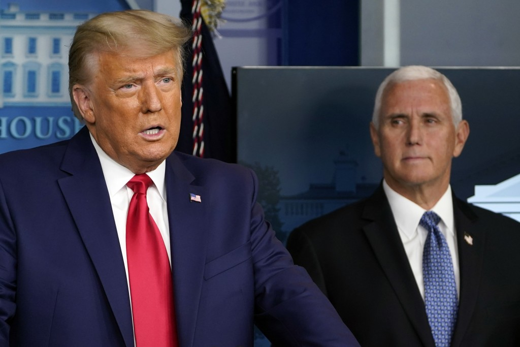 FILE - In this Nov. 24, 2020, file photo President Donald Trump speaks in the press briefing room as Vice President Mike Pence listens in Washington. ...