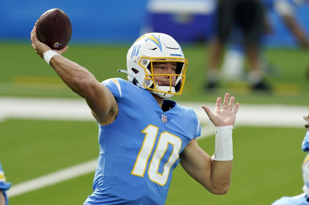 FILE - In this Sunday, Nov. 22, 2020, file photo, Los Angeles Chargers quarterback Justin Herbert throws a pass against the New York Jets during the f...