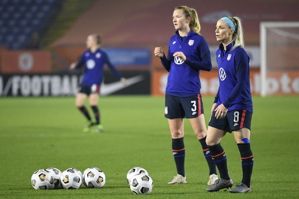 United States' Julie Ertz, right, and United States' Samantha Mewis warm up prior to the international friendly women's soccer match between The Nethe...
