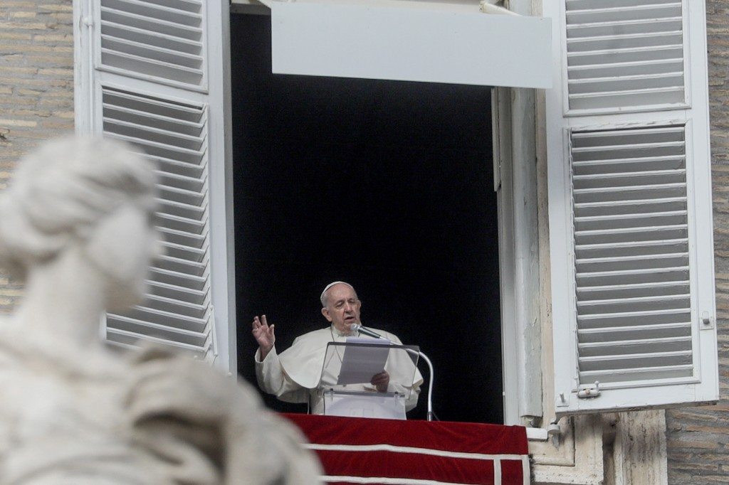 Pope Francis recites the Angelus prayer from his studio window overlooking St.Peter's Square at the Vatican, Sunday, Nov. 29, 2020. Pope Francis, join...