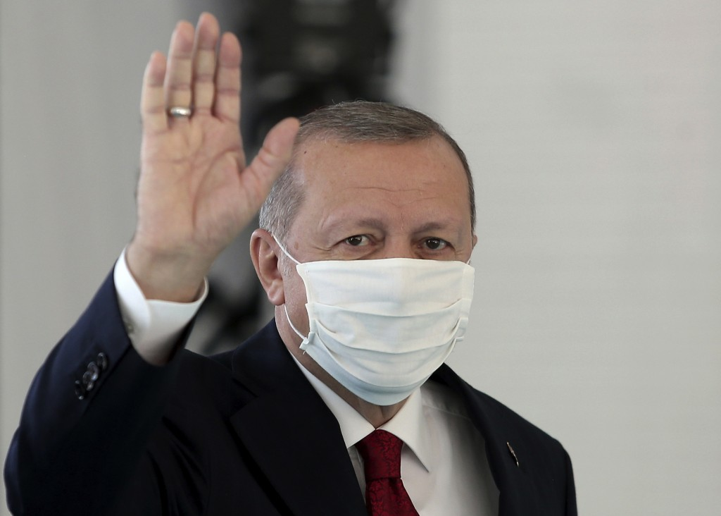 FILE - In this Friday, May 29, 2020, file photo, Turkey's President Recep Tayyip Erdogan, wearing a mask for protection against the coronavirus, arriv...