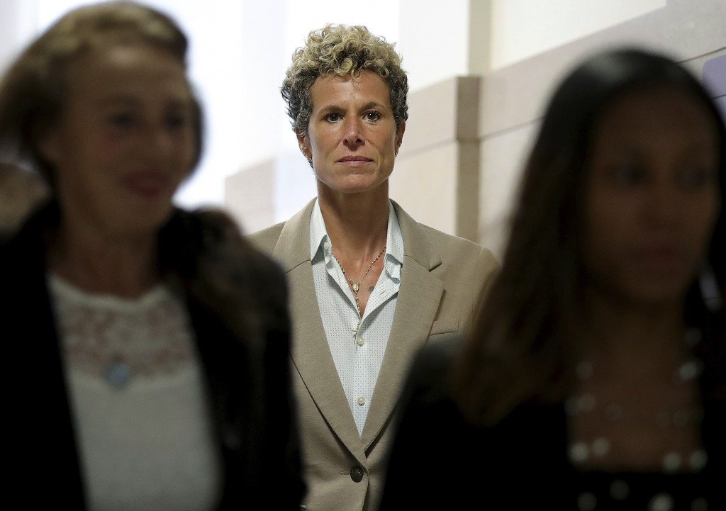 FILE - In this Sept. 24, 2018 file photo, accuser Andrea Constand returns to the courtroom during a lunch break at the sentencing hearing for Bill Cos...