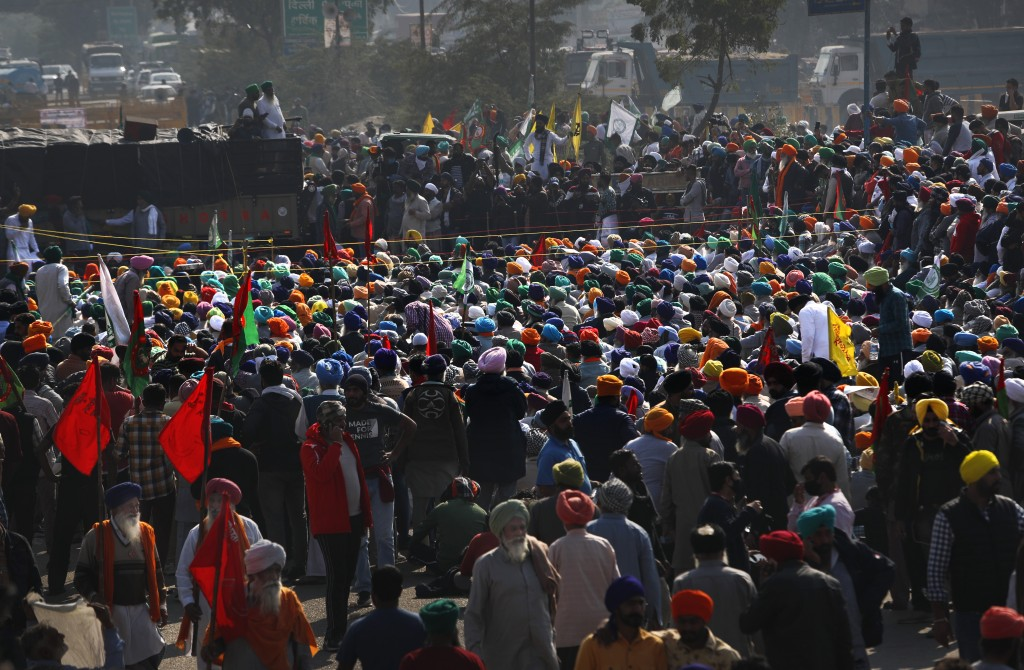 Indian farmers hold a meeting at the Delhi-Haryana state border, India, Sunday, Nov. 29, 2020. Protesting farmers on Sunday rejected the Indian govern...