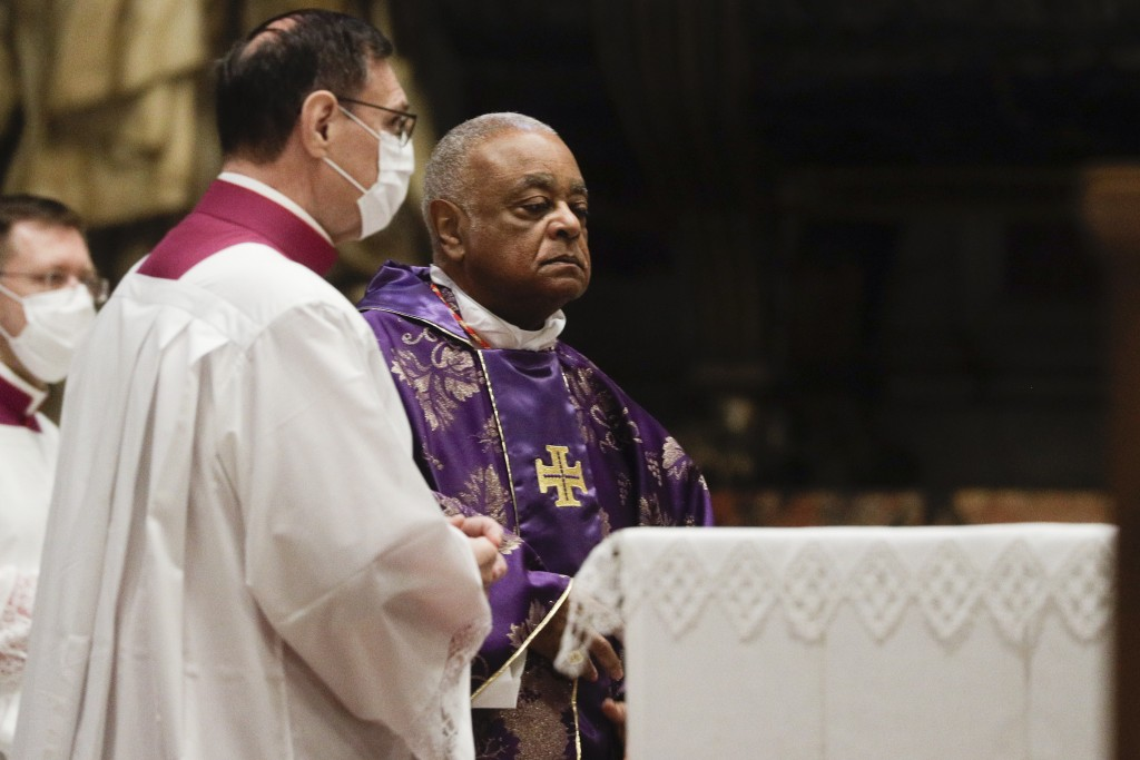 Cardinal Wilton D. Gregory attends a Mass celebrated by Pope Francis the day after the pontiff raised 13 new cardinals to the highest rank in the Cath...
