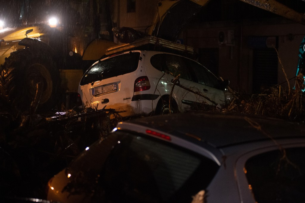 Cars were left among other debris in Bitti, Sardinia, Italy, Saturday, Nov. 28, 2020.  The town of Bitti in Sardinia was hit by a storm and flooded by...