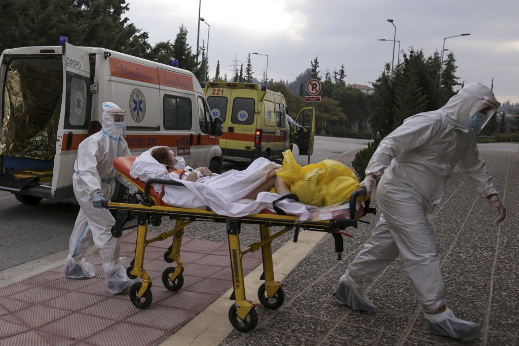 Medical personnel transfer a COVID-19 patient from a state to a private clinic which has been appropriated, in the northern city of Thessaloniki, Gree...