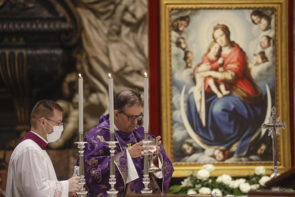 Cardinal Augusto Paolo Lojudice attends a Mass celebrated by Pope Francis the day after the pontiff raised 13 new cardinals to the highest rank in the...