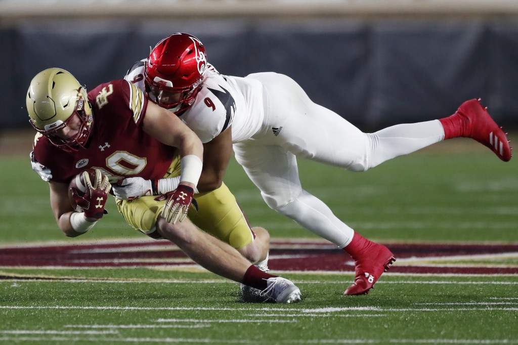 Louisville linebacker C.J. Avery (9) tackles Boston College tight end Hunter Long (80) during the first half of an NCAA college football game, Saturda...