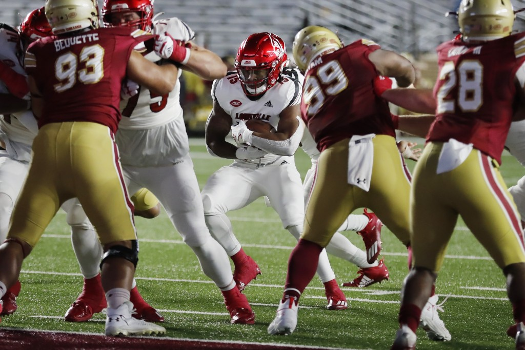 Louisville running back Jalen Mitchell (15) runs for a touchdown during the first half of an NCAA college football game against Boston College, Saturd...
