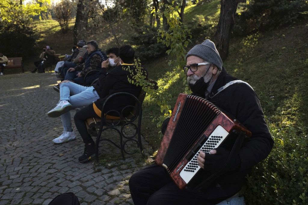 A musician performs in a public garden, in Ankara, Turkey, Friday, Nov. 27, 2020. When Turkey changed the way it reports daily COVID-19 infections, it...
