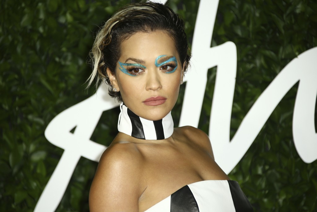 FILE - In this Monday, Dec. 2, 2019 file photo, singer Rita Ora poses for photographers upon her arrival at the British Fashion Awards in central Lond...