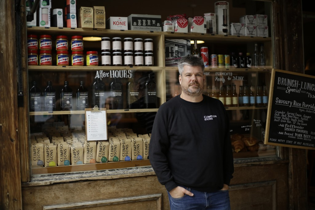 Danny Davies the Commercial Director of Climpson & Sons, poses for a portrait outside their specialty coffee cafe, which is allowed to stay open for t...