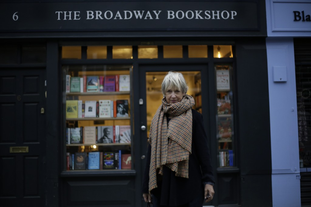 Jane Howe, the owner of the Broadway Bookshop poses for a portrait outside her shop which is temporarily closed for in-store browsing but open for cus...