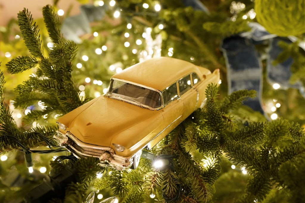 A toy car hangs in a Christmas tree in the East Room of the White House during the 2020 Christmas preview, Monday, Nov. 30, 2020, in Washington. (AP P...