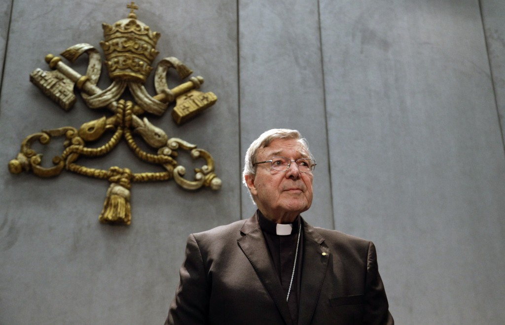 FILE - In this June 29, 2017, file photo, Cardinal George Pell prepares to make a statement, at the Vatican. Cardinal George Pell, who was convicted a...