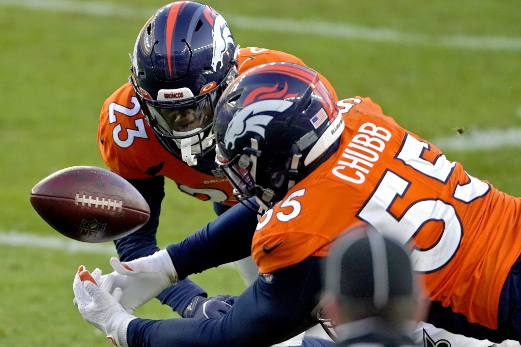 Denver Broncos outside linebacker Bradley Chubb (55) and cornerback Michael Ojemudia (23) can't hold on to an incomplete pass against the New Orleans ...