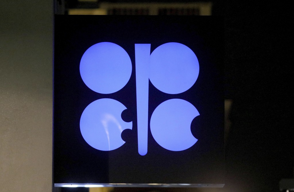 FILE - In this Dec. 19, 2019 file photo, the advertising label of the Organization of the Petroleum Exporting Countries, OPEC, shines at their headqua...