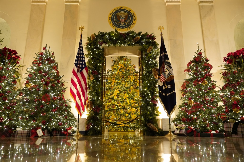 Cross Hall and the Blue Room are decorated during the 2020 Christmas preview at the White House, Monday, Nov. 30, 2020, in Washington. (AP Photo/Patri...
