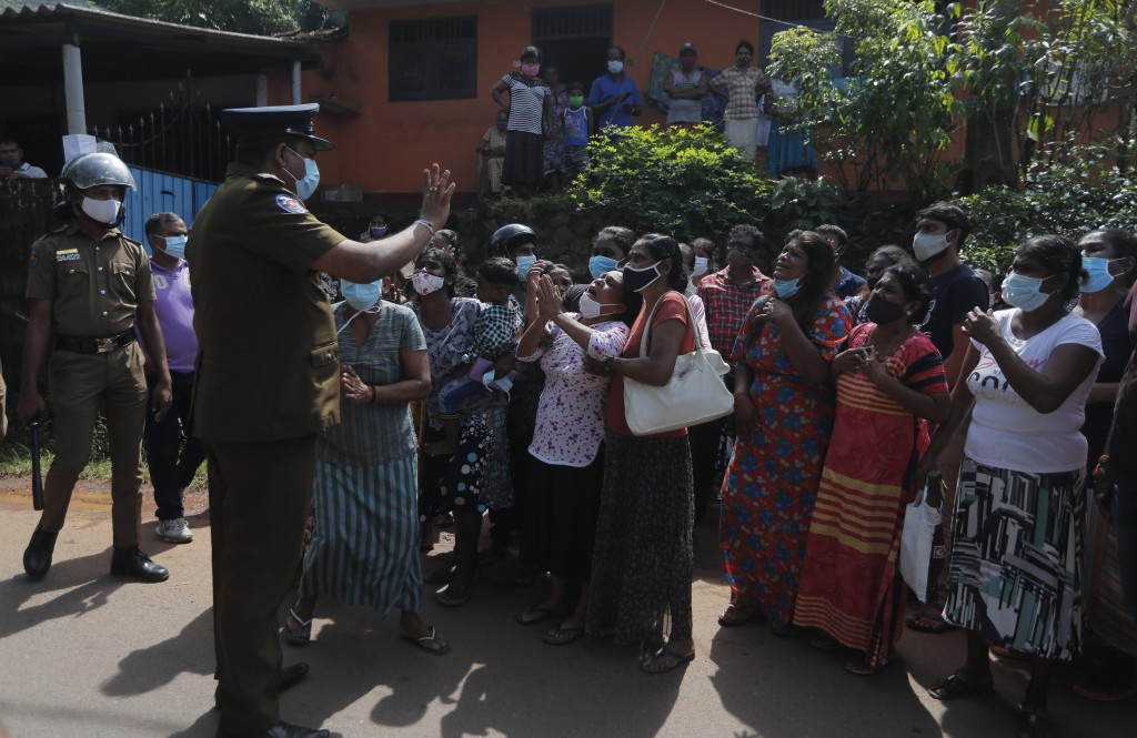 Family members of inmates gather demanding to know the condition of their relatives outside the Mahara prison complex following an overnight unrest in...