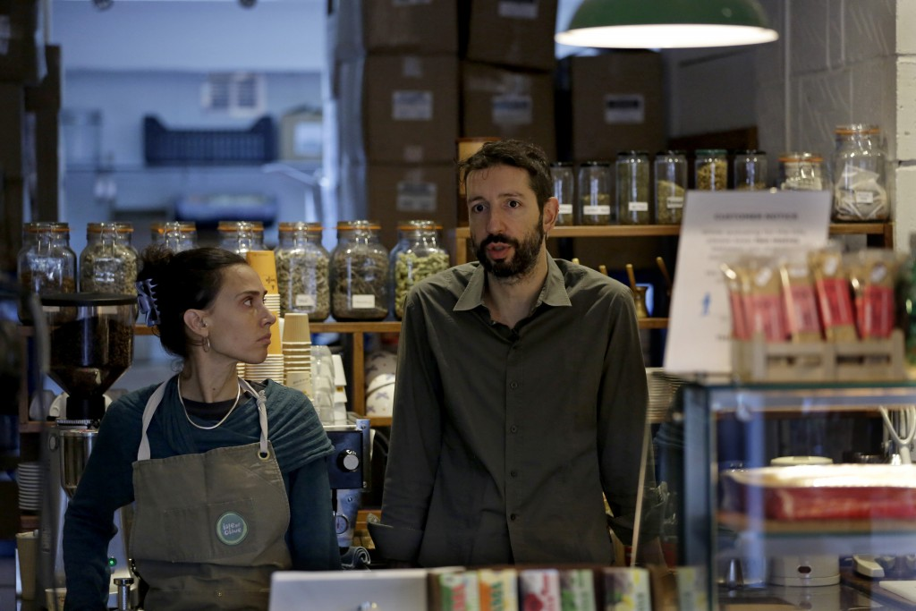Paulina Filippou and Grigorios Vaitsas are interview by The Associated Press in their 'Isle of Olive' Natural Greek Products store and delicatessen, w...