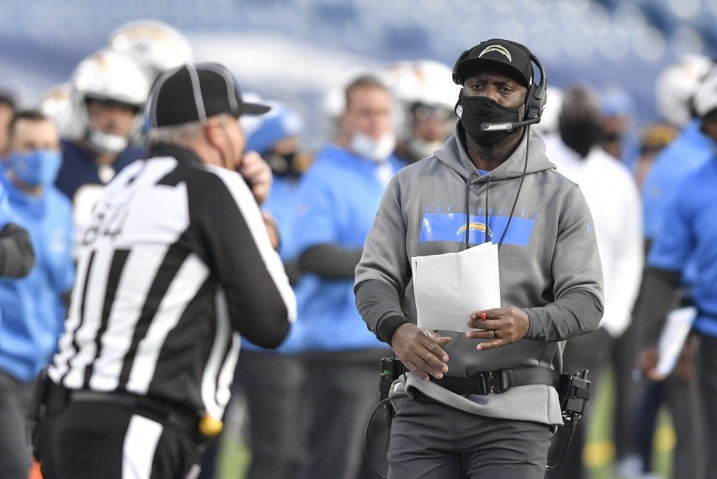 Los Angeles Chargers head coach Anthony Lynn, right, works the sideline during the second half of an NFL football game against the Buffalo Bills, Sund...