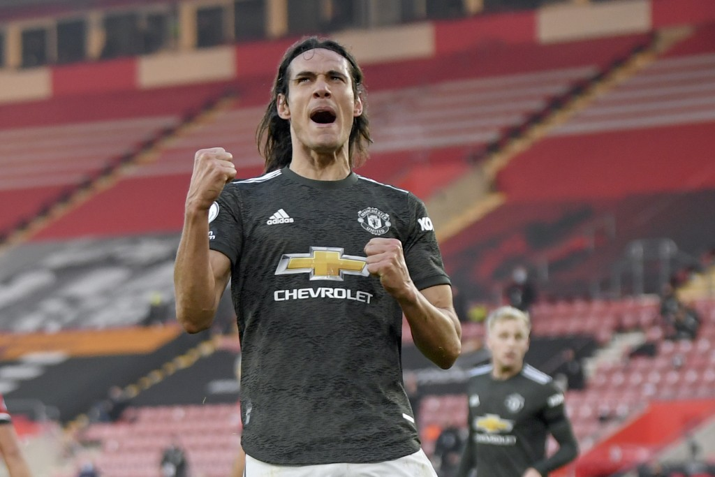 Manchester United's Edinson Cavani celebrates after scoring his side's second goal during an English Premier League soccer match between Southampton a...