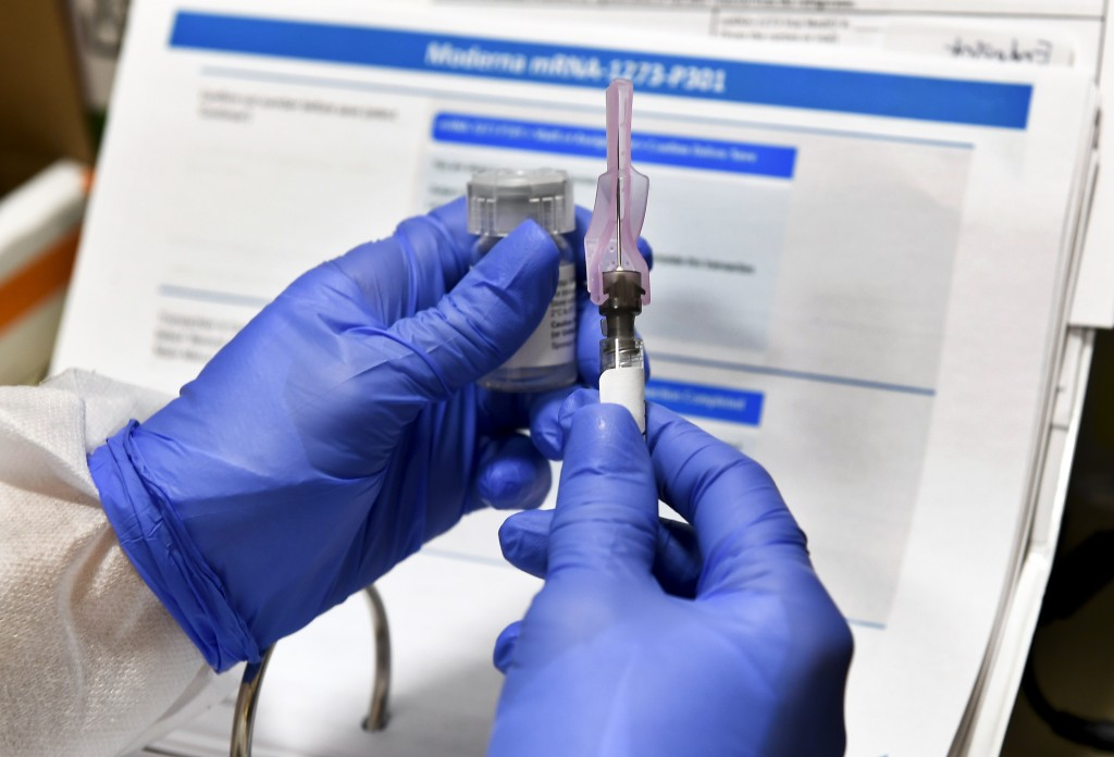 Nurse Kathe Olmstead prepares a shot that is part of a possible COVID-19 vaccinein Binghamton, N.Y.