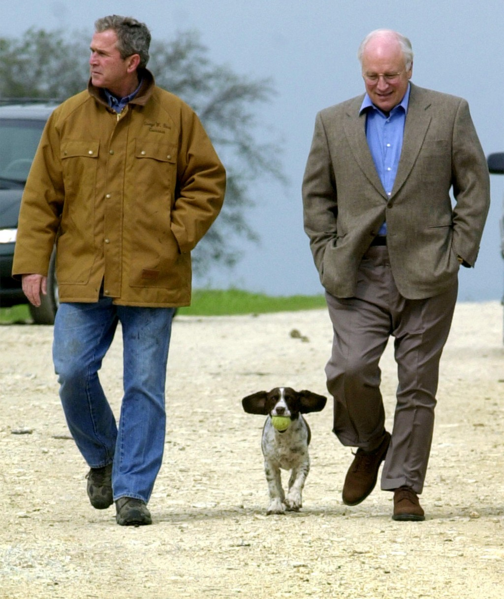 FILE- This Nov. 11, 2000 file photo shows then-Republican presidential candidate Texas Gov. George W. Bush and running mate Dick Cheney walk down a di...
