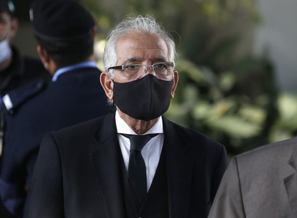 Mahmood Shaikh, defense lawyer for British-born Pakistani Ahmed Omar Saeed Sheikh, leaves the Supreme Court after an appeal hearing in the Daniel Pear...