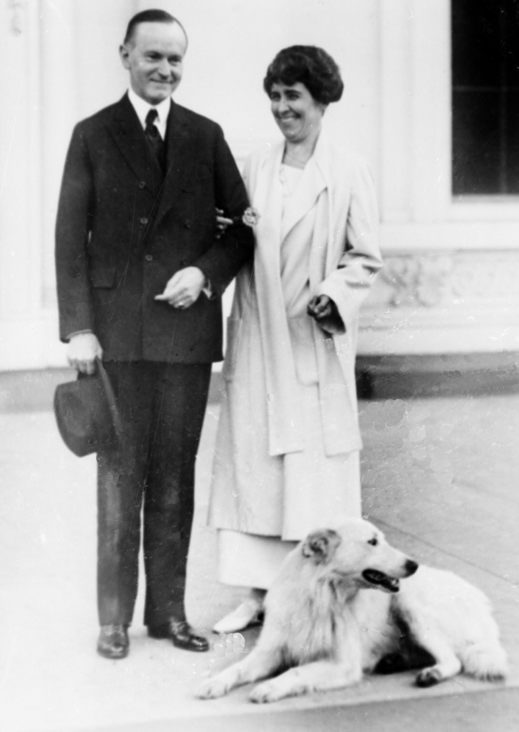 FILE - In this Nov. 5, 1924, file photo President Calvin Coolidge and first lady Grace Coolidge are shown with their dog at the White House portico in...