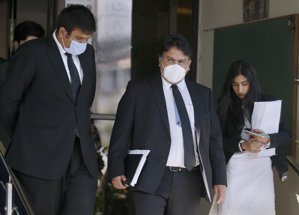 Faisal Siddiqi, center, a lawyer for the family of Daniel Pearl, an American reporter who was kidnapped and killed in Pakistan in 2002, leaves the Sup...