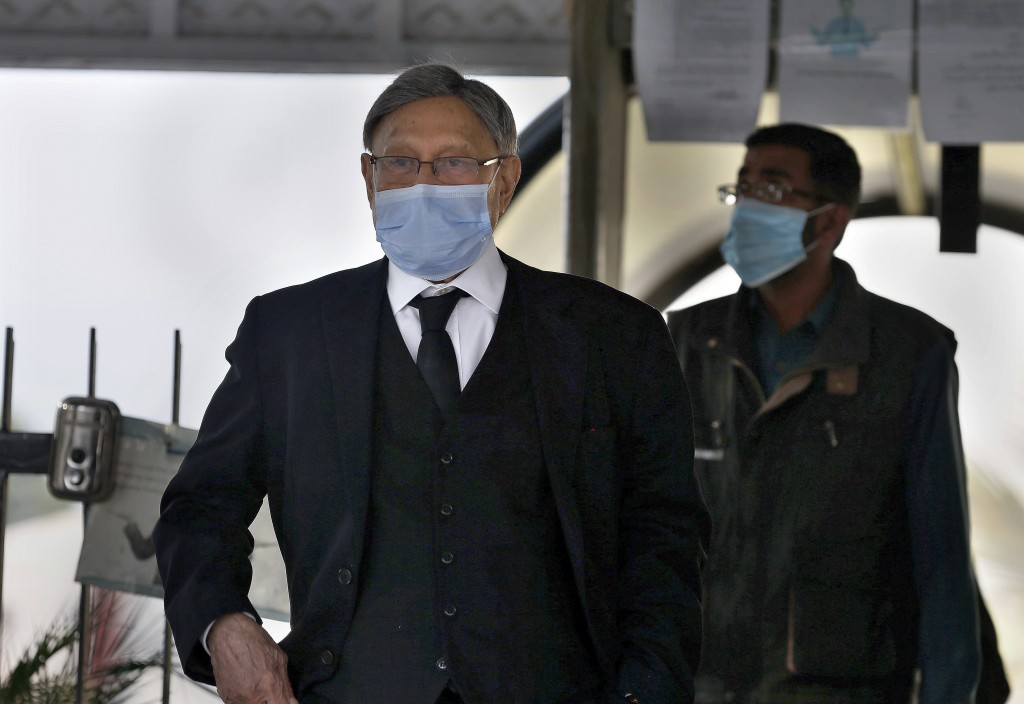 Farooq Naek, a lawyer for the provincial Sindh government, leaves the Supreme Court after an appeal hearing in the Daniel Pearl case, in Islamabad, Pa...