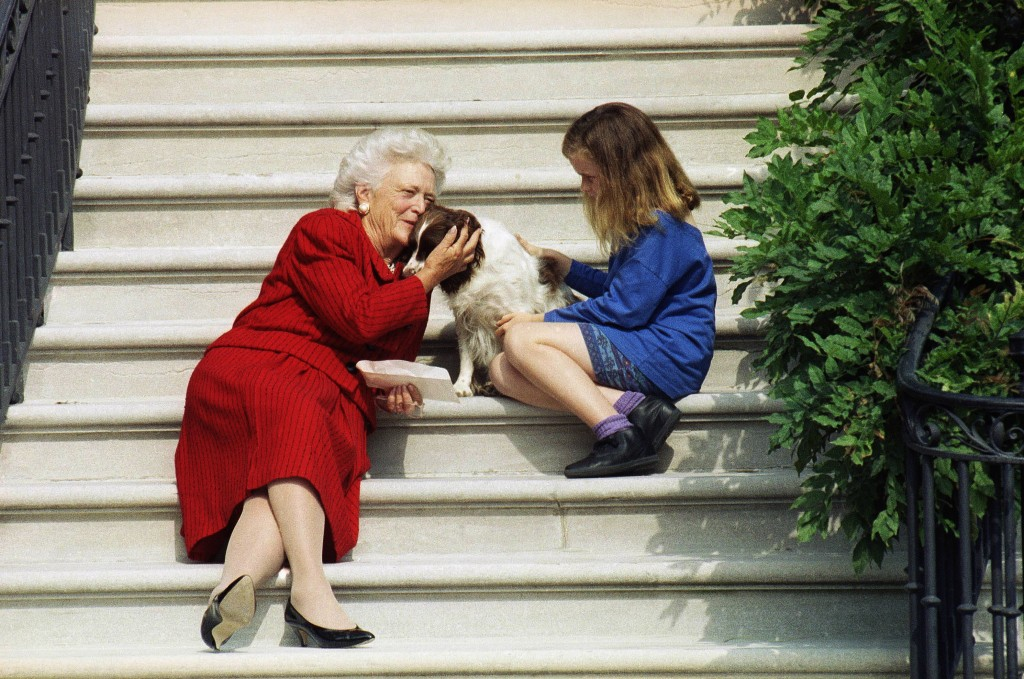 FILE - In this Sept. 13, 1991, file photo, first lady Barbara Bush, her granddaughter Barbara, and Millie wait on the steps of the White House for Pre...