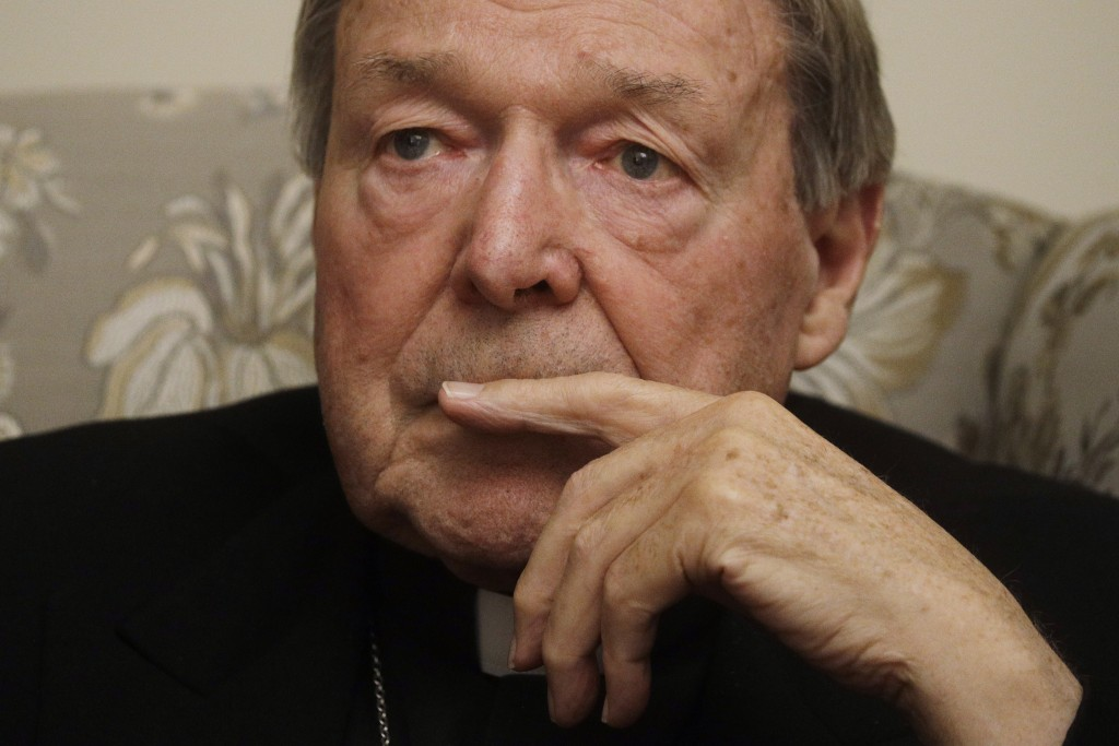 Cardinal George Pell ponders a question during an interview with the Associated Press inside his residence near the Vatican in Rome, Monday, Nov. 30, ...
